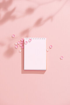 Pink paper with flowers.