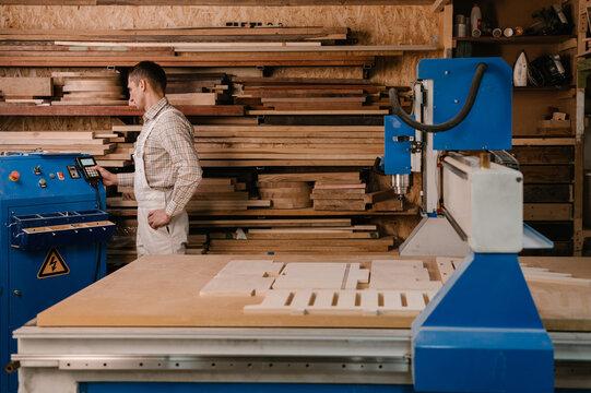 Joiner adjusting settings on CNC machine