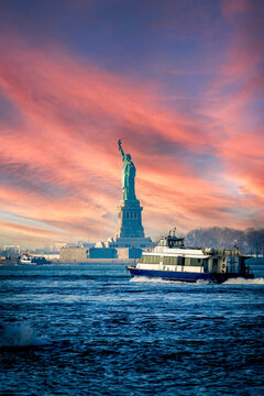 Statue of Liberty and boat at Hudson River against sky during sunset, New York, USA