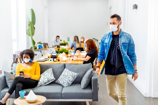 Business people wearing face mask while working at office