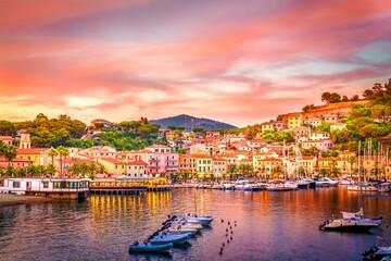 Wall Mural - Harbor and village  Porto Azzurro at sunset, Elba islands, Tuscany, Italy.