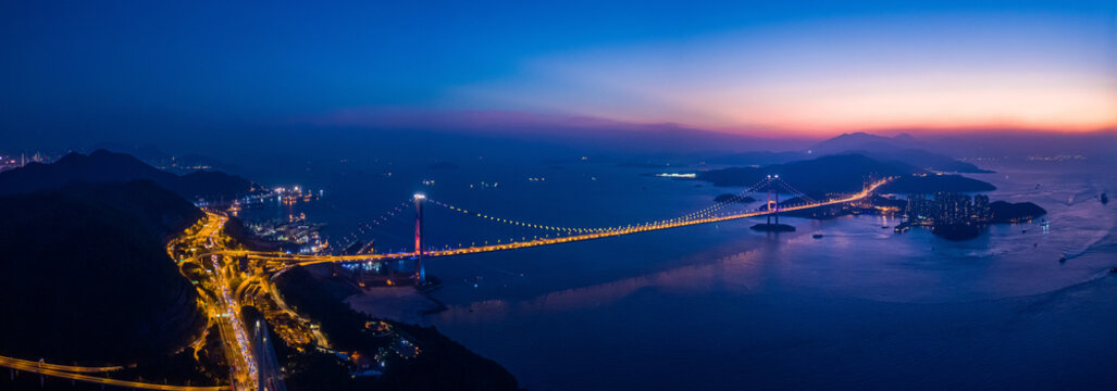 Aerial night view of Tsing Ma Bridge, famous landmark, Hong Kong
