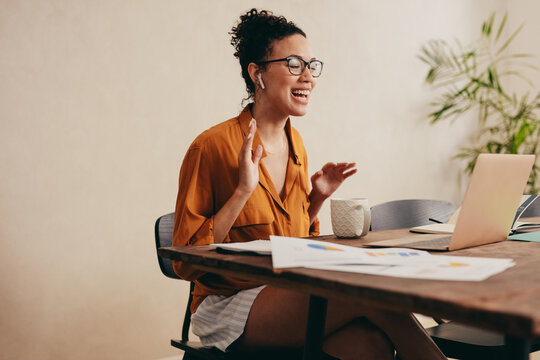 Woman on a video conference call working from home