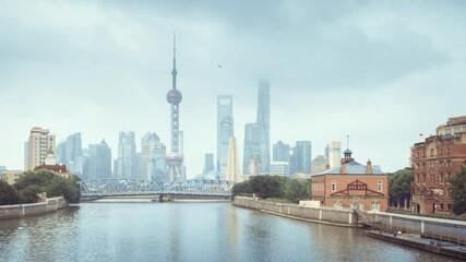 Fototapete - hyper lapse of sunset, Shanghai skyline and Waibaidu bridge, China