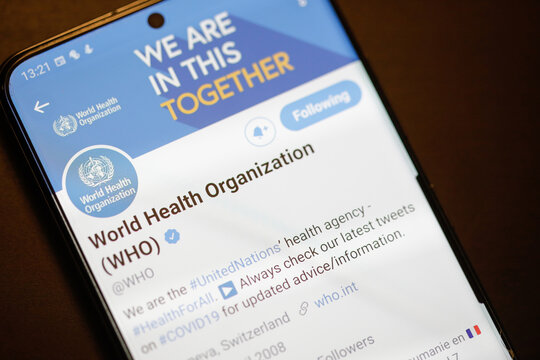 Details with the Twitter account of World Health Organization (WHO) on a mobile device screen.