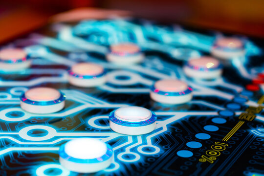 Close-up of an electronic arcade game. Board game button abstraction