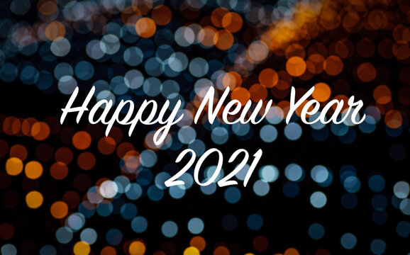Text of happy new year 2021 on colorful light bokeh background