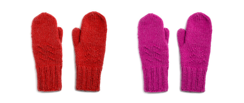 Red and pink mittens isolated on white background
