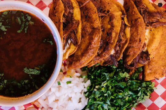 Birria tacos with beans
