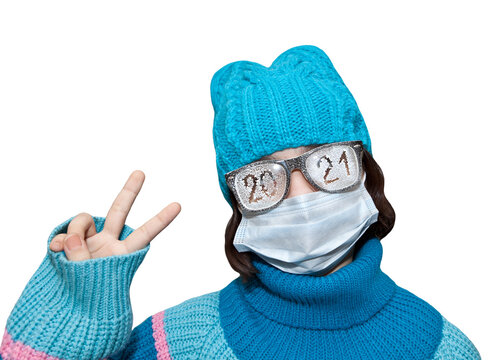 a teenage girl wearing a medical mask and glasses with the date 2021 scrawled on it. Happy new year.