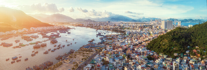 Panoramic view on city of Nha Trang from mountains during sunset. Vietnam