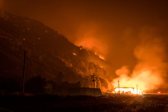 oregon wildfire on mountain with buring barn