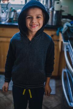 Smiling Boy in Kitchen I