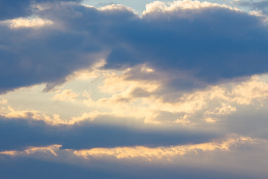 cloudy sky in yellow light. natural background at sunrise. inspiring scene