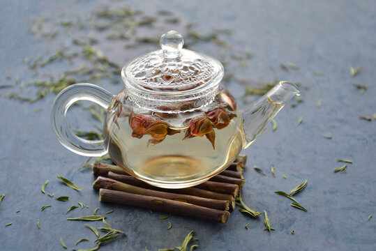 Chinese tea from rosebuds in a glass teapot on a dark background