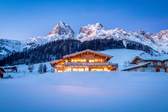 Wooden chalet in the alps on a cold winter evening