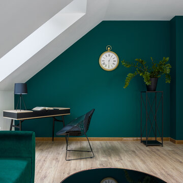 Attic room with emerald green wall