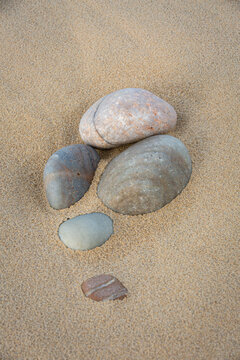 Cluster of Pebbles on Sand