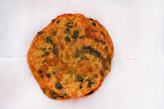 Delicious Indian Masala Puri or Methi Puri. Indian Bread Made of fenugreek leaves.