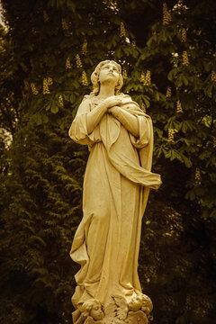 Ancient statue of Mary Magdalene praying (Faith, religion, faith, God concept)