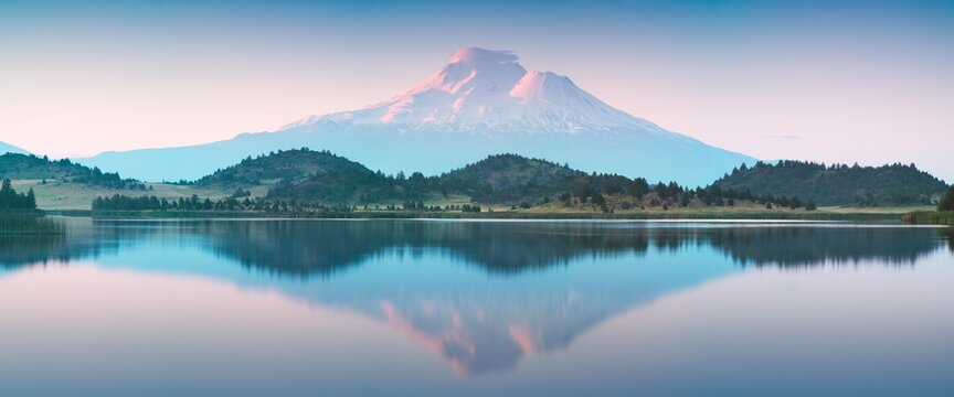 Beautiful Mount Shasta and Siskiyou Lake  A reflection of snow capped Mount Shasta in a clear water in lake at sunrise in California State, USA. Siskiyou County