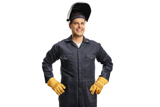 Smiling welder in a uniform with a protective helmet