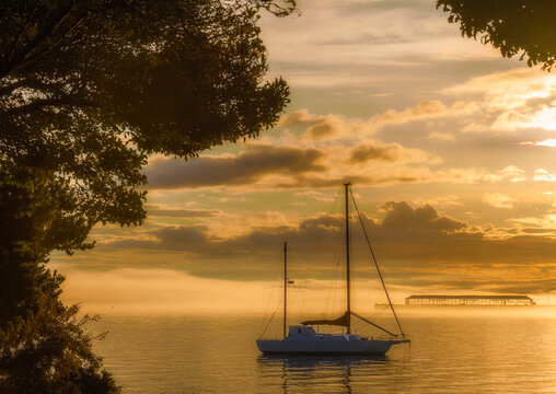 Sunrise silhouettes boat in Port Angeles Washington