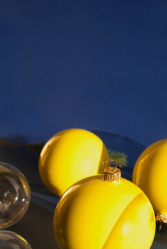 Christmas decorative balls on blue background with long shadows. Christmas composition. Winter holiday theme