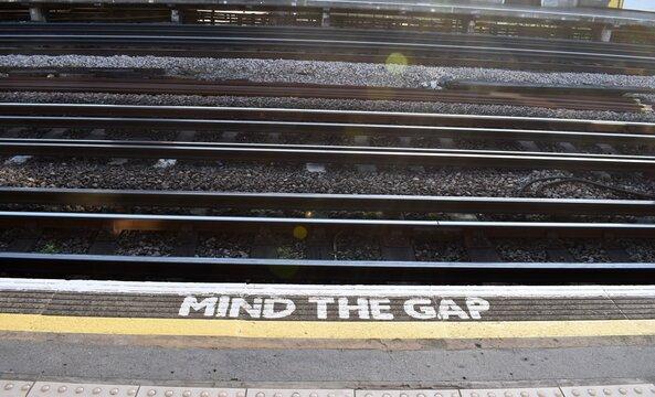 Mind the gap warning on the platform