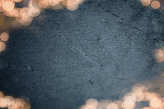 Festive light Bokeh over Dark Slate/Shale Background