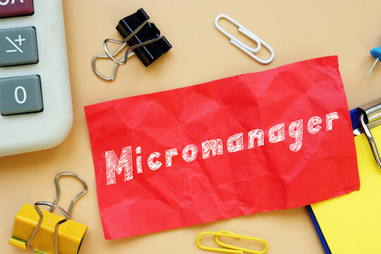 Business concept meaning Micromanager with phrase on the sheet.