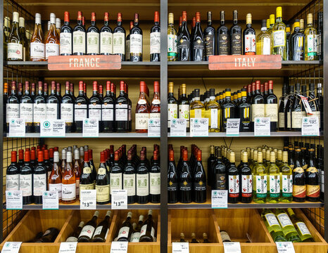 WILLIAMSBURG, VA, USA - CIRCA AUGUST 2015: French and Italian wines on shelves in supermarket.