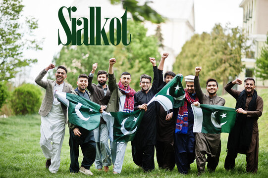 Sialkot city. Group of pakistani man wearing traditional clothes with national flags. Biggest cities of Pakistan concept.