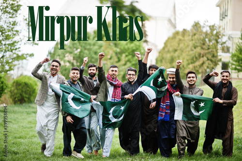 Mirpur Khas city. Group of pakistani man wearing traditional clothes with national flags. Biggest cities of Pakistan concept.