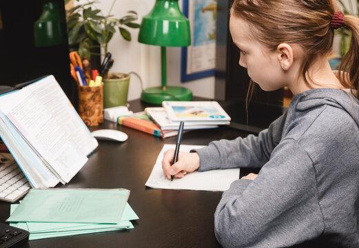 Child studying at home homeschooling during Coronavirus lockdown