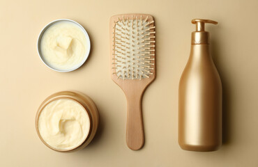 Wall Mural - Hair cosmetic products and brush on beige background, flat lay