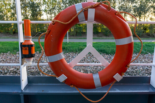 Life saving ring on board the vessel. Lifering. Man overboard ring with light buoy.