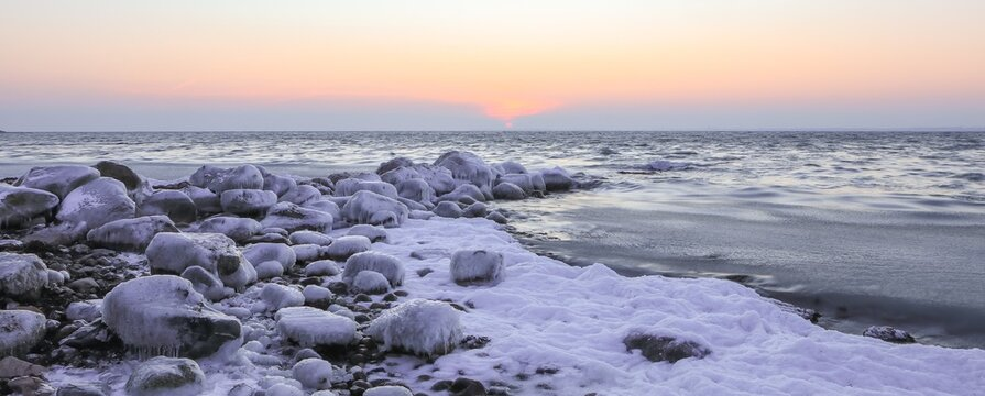 snow covered coastline in winter, banner