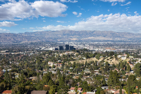View of Woodland Hills with partly cloudy sky in the west San Fernando Valley area of Los Angeles, California.
