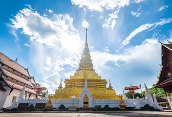 Dramatic sky with Wat Phra That Chae Hang the most important temple in Nan province of Thailand. The chedi contains a relic of the Buddha dating back to 14th century. Wall mural