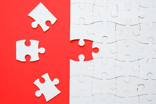 A picture of 3 jigsaw with one empty puzzle need to fit in for problem solving concept.