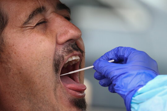 A person is swabbed by a medical professional at a drive-through coronavirus disease testing clinic in Sydney