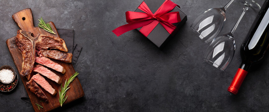 Valentines day or Christmas gift box with wine and grilled steak