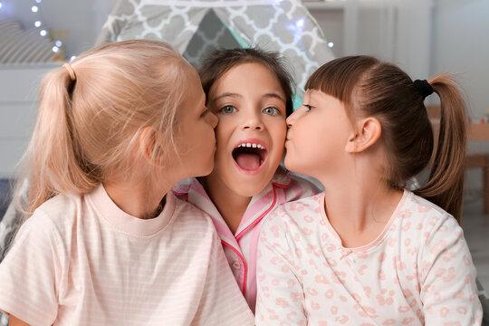 Cute little girls in bedroom