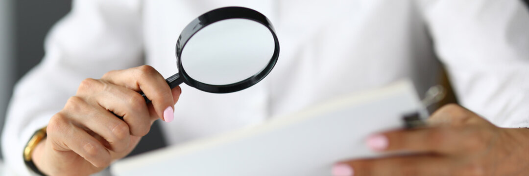 Silhouettes of woman holding magnifying glass and documents. Search for new solutions and tasks for business concept