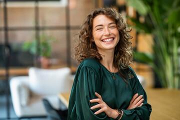 Fototapeta Beautiful woman smiling with crossed arms