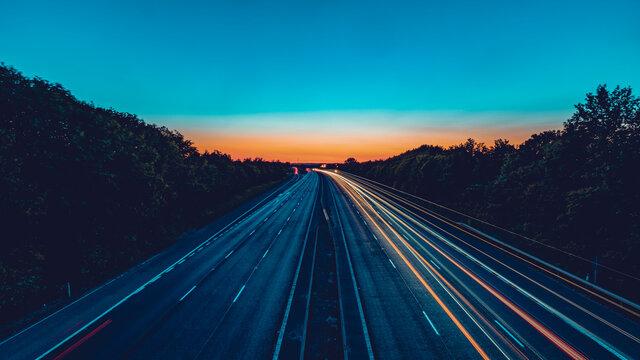 Light streaks shot of motorway with traffic flow on one side