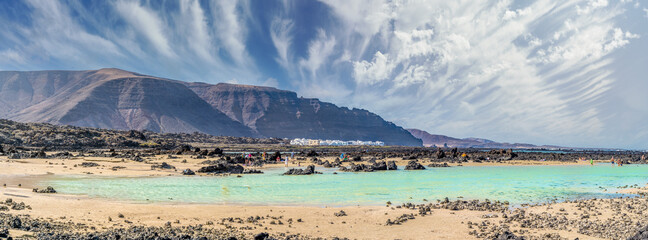 Wall Mural - Landscape with turquoise ocean water on Caleton Blanco, Lanzarote, Canary Islands, Spain