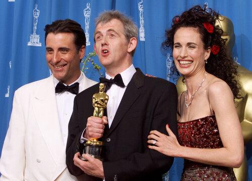 BEST ORIGINAL SCORE WINNER WARBECK WITH PRESENTERS GARCIA AND MACDOWELL.