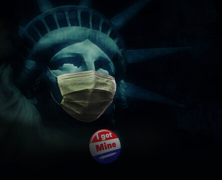 """The Statue of Liberty is wearing a surgical mask and a badge that says """"I got mine"""" referring to having received the Covid-19, coronavirus vaccine injection."""